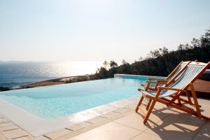 The Leto Luxury Villa in Mykonos private swimming pool with a panoramic view of the Aegean sea.