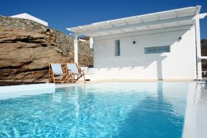 Beautiful private pool of the Leto Villa in Houlakia Mykonos with 2 sun beds.