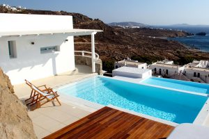 Top angle of the Leto Luxury Villa in Mykonos private pool. Majestic panoramic sea views.