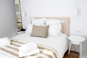 The Leto Luxury Villa in Mykonos second bedroom with large double bed and bedside tables.