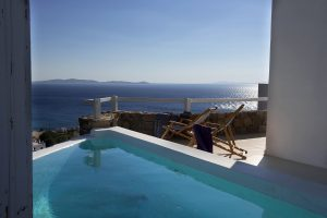 View of the Aegean sea from the private pool of the Artemis Luxury Villa in Houlakia, Mykonos.