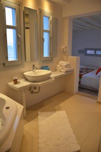 The Artemis Luxury Villa wash basin in the modern design bathroom with outside view of the sea.