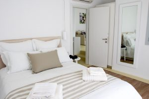 The Artemis Luxury Villa in Mykonos bedroom with large double bed and bedside tables.