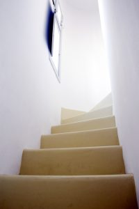Staircase leading to the top floor of the Artemis Luxury Villas in Houlakia, Mykonos.