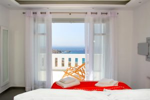 View of the Aegean sea as seen from inside the Asteria Luxury Villa bedroom in the morning.