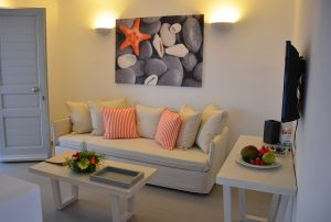 Τhe Asteria Luxury Villa in Mykonos sitting room area with sofa, table and flat screen tv.