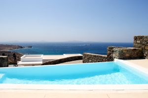 The Hera Luxury Villa private swimming pool with a panoramic view of the Aegean sea and Mykonos.