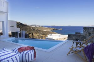 View of the endless Aegean sea as seen from the Hera Luxury Villa swimming pool during the afternoon
