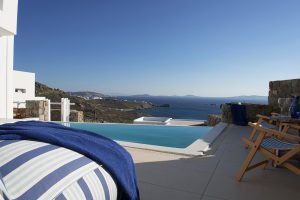 The Hera Luxury Villa in Houlakia, Mykonos private pool with panoramic view of the Aegean sea.