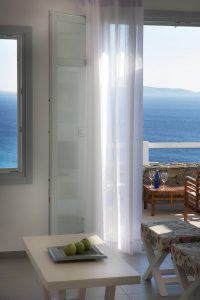 View of the Aegean sea as seen from the Hera Luxury Villa in Houlakia, Mykonos sitting room.