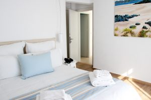 The Leto Luxury Villa in Mykonos bedroom, with double bed and plenty of sunlight.
