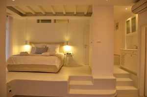 The ground floor open plan bedroom of the Hera Luxury Villa in Houlakia, Mykonos.